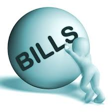person-pushing-ball-with-bills-written-on-it