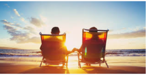 two-people-sitting-in-chairs-at-beachs