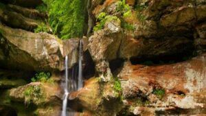 water-falling-from-rocks-into-lake