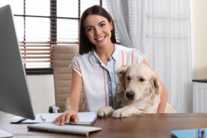 woman-and-dog-rking-together-at-computer