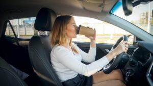 Woman-sipping-coffee-while-driving-to-work