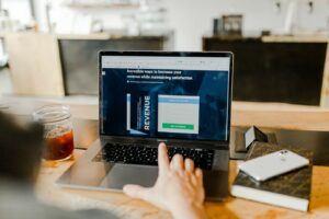 laptop showing revenue stats