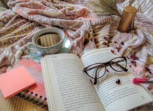 book, glasses, coffee and notebooks