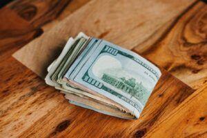 folded money on wood surface