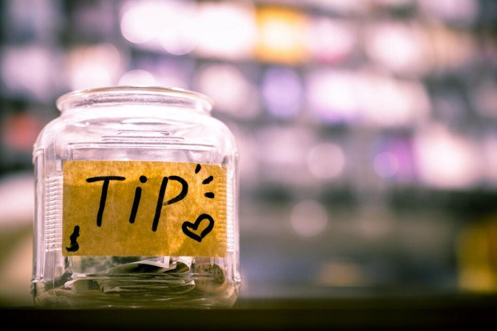 money in jar labeled tips